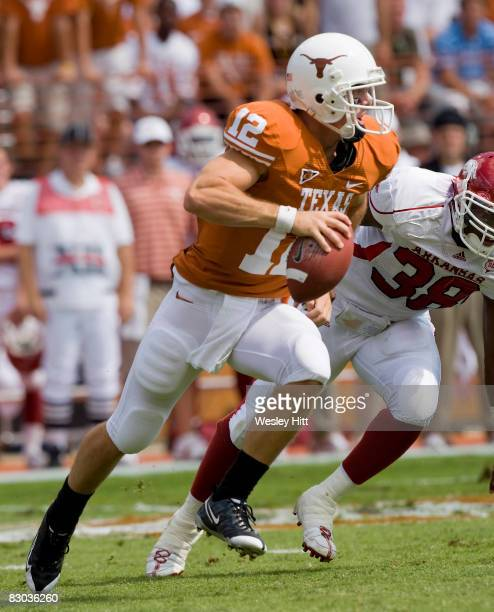 Colt McCoy of the Texas Longhorns rolls out looking for a receiver against the Arkansas Razorbacks at Darrell K. Royal-Texas Memorial Stadium on...