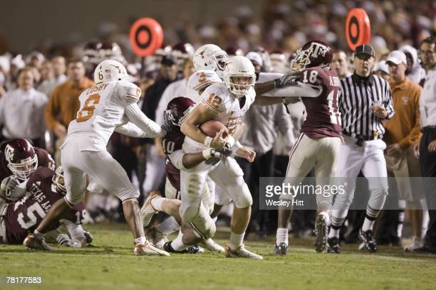 Colt McCoy of the Texas Longhorns runs with the ball against the Texas AM Aggies at Kyle Field on November 23 2007 in College Station Texas The...