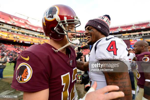 Colt McCoy of the Washington Redskins and Deshaun Watson of the Houston Texans talk after the Texans defeated the Redskins 2321 at FedExField on...
