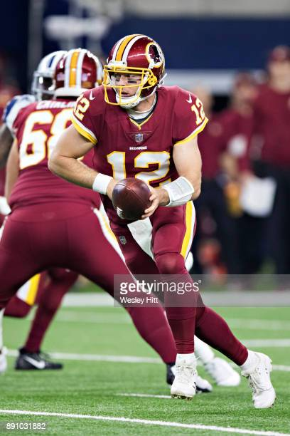 Colt McCoy of the Washington Redskins drops back to make a hand off during a game against the Dallas Cowboys at ATT Stadium on November 30 2017 in...