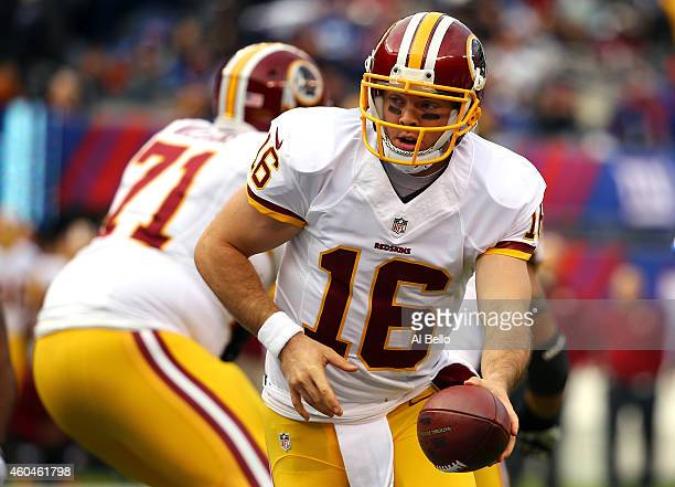 Colt McCoy of the Washington Redskins hands the ball off in the first quarter against the New York Giants during their game at MetLife Stadium on...