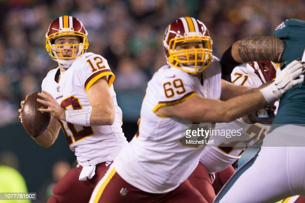 Colt McCoy of the Washington Redskins looks to pass the ball as Luke Bowanko blocks against the Philadelphia Eagles at Lincoln Financial Field on...