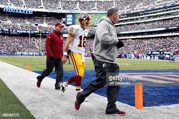 Colt McCoy of the Washington Redskins walks off the field to the locker room after being injured in the first quarter against the New York Giants...