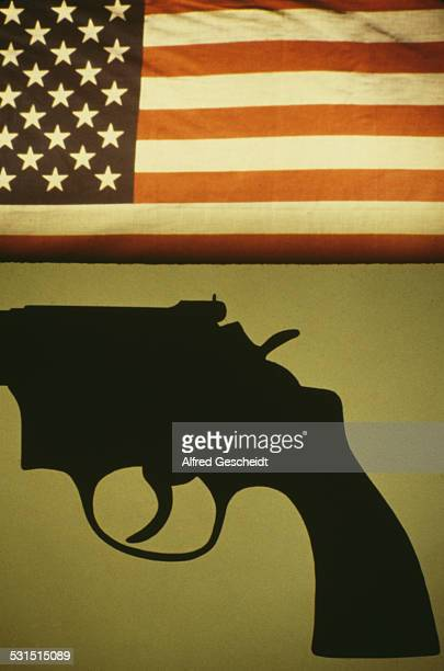 A Colt Python a 357 Magnum caliber revolver set against the background of an American flag 1981