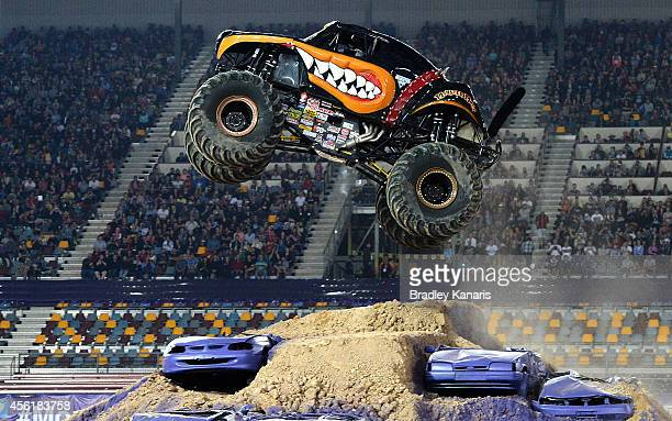 Colt Stephens driving Monster Mutt Rottweiler launches over the jump during Monster Jam at Queensland Sport and Athletics Centre on September 27 2014...