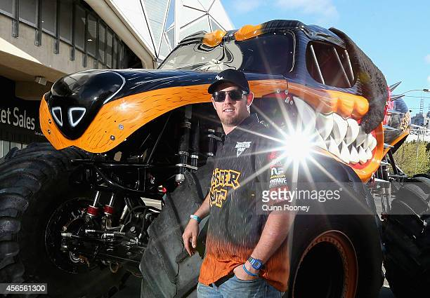 Colt Stephens poses with his truck Monster Mutt Rottweiler during a media opportunity ahead of Monster Jam at AAMI Park on October 3 2014 in...