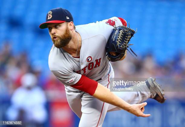 Colten Brewer of the Boston Red Sox delivers a pitch in the third inning during a MLB game against the Toronto Blue Jays at Rogers Centre on July 04...