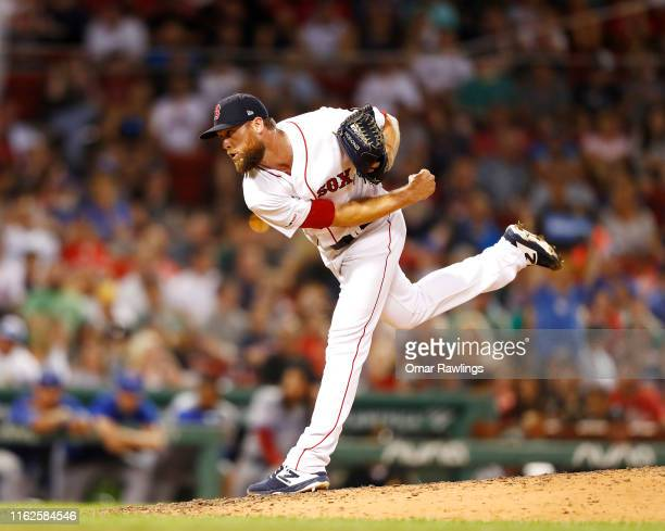 Colten Brewer of the Boston Red Sox pitches at the top of the seventh inning of the game against the Toronto Blue Jays at Fenway Park on July 16 2019...