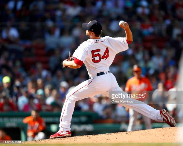 Colten Brewer of the Boston Red Sox pitches at the top of the sixth inning of the game against the Baltimore Orioles at Fenway Park on April 13 2019...