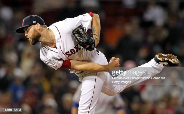 Colten Brewer of the Boston Red Sox pitches during the fourth inning of the MLB game against the Texas Rangers at Fenway Park on June 13 2019 in...