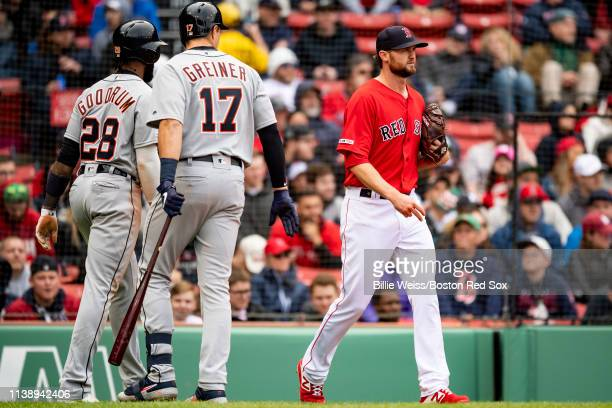 Colten Brewer of the Boston Red Sox reacts after allowing Nico Goodrum and Greyson Greiner of the Detroit Tigers to score on a double during the...