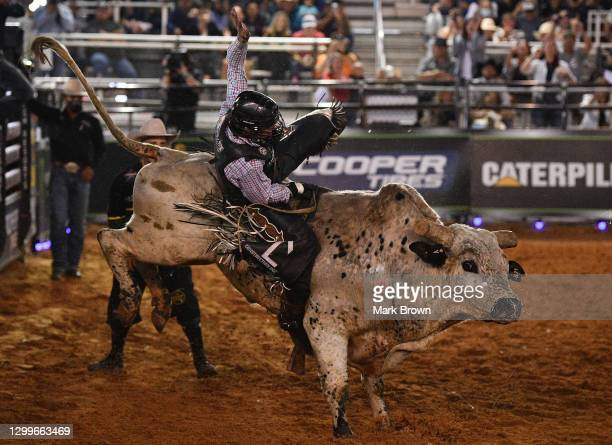 Colten Fritzlan rides Zero Time during the PBR Unleash The Beast bull riding event at Okeechobee Agri-Civic Center on January 31, 2021 in Okeechobee,...