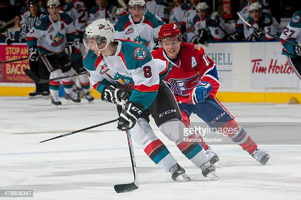 Colten Martin of the Kelowna Rockets skates with the puck as Mitch Holmberg of the Spokane Chiefs stick checks him during second period on March 5,...