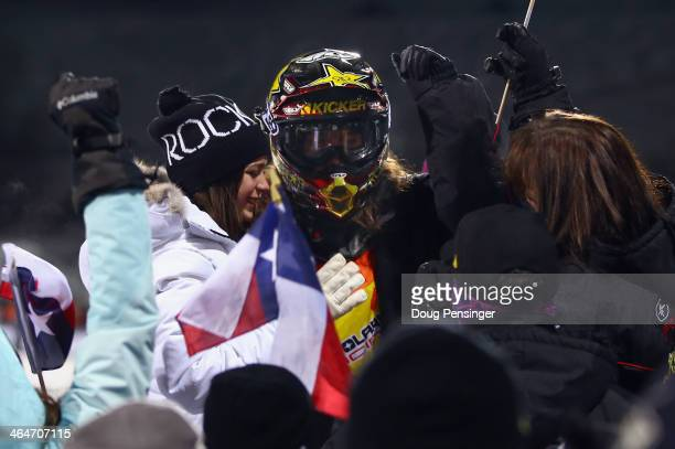Colten Moore is joied by his girlfriend Ashley Hammons and friends and family after his first run in the snowmobile freestyle finals at Winter XGames...