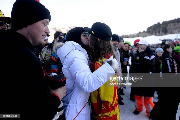 Colten Moore kisses his girlfriend Ashley Hammons as he celebrates his late brother Caleb who was killed in the snowmobile freestyle event at the...