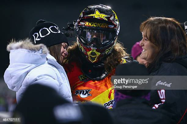 Colten Moore talks with his girlfriend Ashley Hammons and his mother Michele Moore after his first run in the snowmobile freestyle finals at Winter...