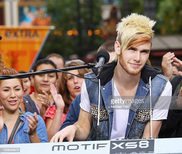 Colton Dixon performs on EXTRA at The Grove on November 8 2012 in Los Angeles California