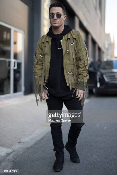 Colton Haynes is seen attending Stampd/Willy Chavarria/Orley while wearing an army green strapped jacket with black hoodie on February 2 2017 in New...