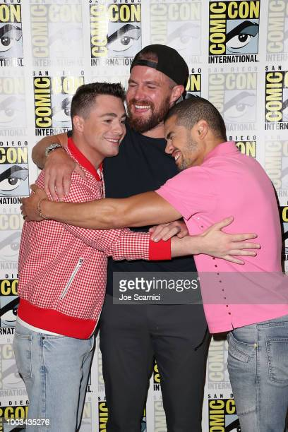 Colton Haynes Stephen Amell and Rick Gonzalez attend the 'Arrow' press line at ComicCon International 2018 on July 21 2018 in San Diego California