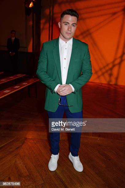 Colton Haynes wearing Paul Smith attends the Paul Smith SS19 Menswear Show during Paris Fashion Week at Elysee Montmartre on June 24 2018 in Paris...