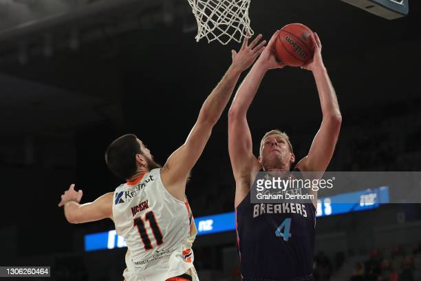 Colton Iverson of the Breakers drives at the basket during the NBL Cup match between the New Zealand Breakers and the Cairns Taipans at John Cain...