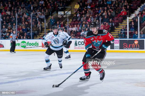 Colton Kroeker of the Kootenay Ice skates over the blue line in pursuit of Cal Foote of the Kelowna Rockets during third period on December 2 2017 at...