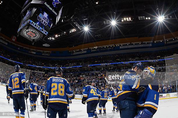 Colton Parayko and Brian Elliott of the St Louis Blues celebrate after defeating the Los Angeles Kings in overtime at the Scottrade Center on...