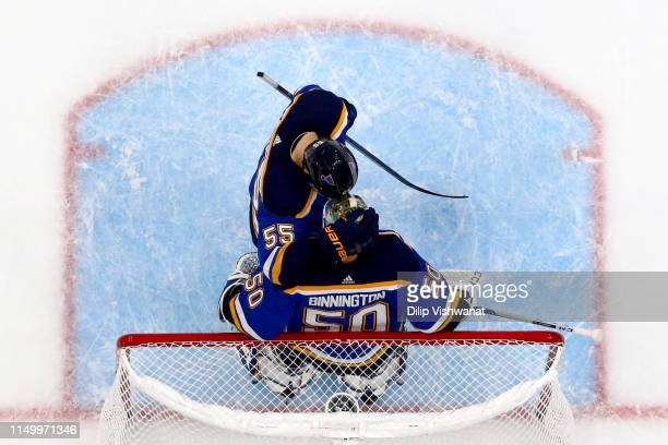 Colton Parayko and Jordan Binnington of the St Louis Blues celebrate after defeating the San Jose Sharks with a score of 2 to 1 in Game Four of the...