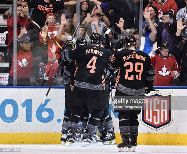 Colton Parayko and Nathan MacKinnon celebrate after Team North America scores a third period goal on Team Russia during the World Cup of Hockey 2016...