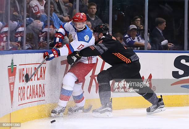 Colton Parayko of Team North America hits Pavel Datsyuk of Team Russia into the boards during the World Cup of Hockey 2016 at Air Canada Centre on...