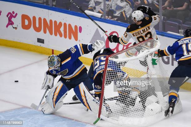 Colton Parayko of the St Louis Blues and Karson Kuhlman of the Boston Bruins collide into the net and knock it free in Game Six of the 2019 NHL...