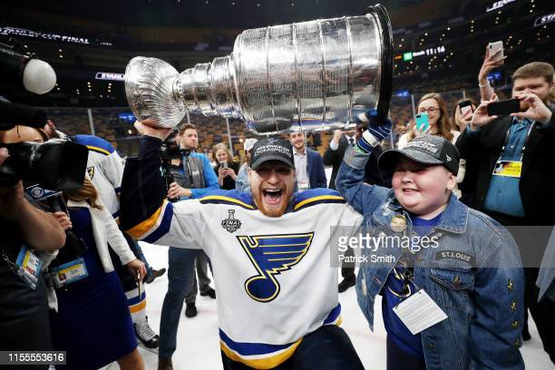 Colton Parayko of the St Louis Blues and Laila Anderson celebrate with the Stanley Cup after defeating the Boston Bruins in Game Seven to win the...