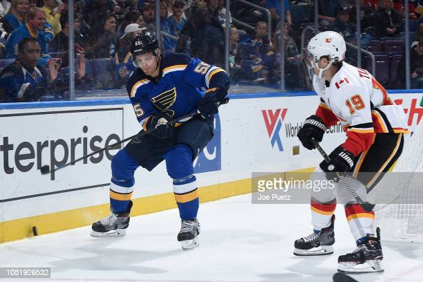 Colton Parayko of the St Louis Blues and Matthew Tkachuk of the Calgary Flames look for control of the puck at Enterprise Center on October 11 2018...