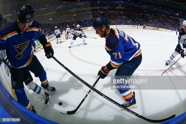 Colton Parayko of the St Louis Blues and Vladimir Sobotka of the St Louis Blues fight for control of the puck against the Winnipeg Jets at Scottrade...