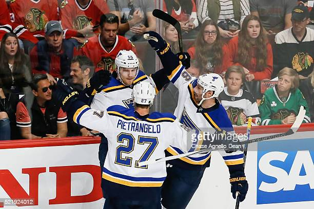 Colton Parayko of the St Louis Blues celebrates with Alex Pietrangelo and Troy Brouwer after scoring in the first period of Game Three of the Western...
