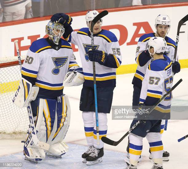 Colton Parayko of the St. Louis Blues congratulates goalie Jordan Binnington after defeating the Winnipeg Jets in Game One of the Western Conference...