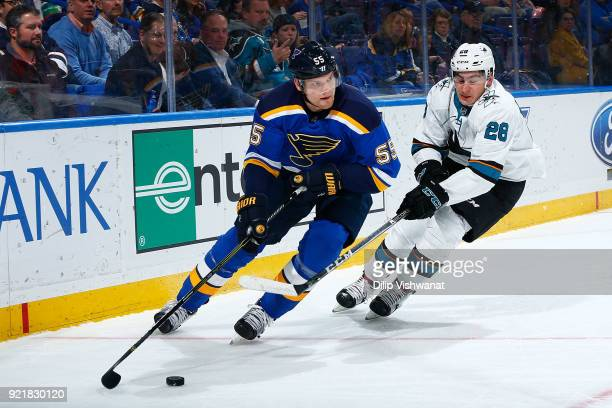 Colton Parayko of the St Louis Blues controls the puck against Timo Meiern of the San Jose Sharks at Scottrade Center on February 20 2018 in St Louis...