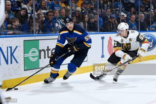 Colton Parayko of the St Louis Blues controls the puck as David Perron of the Vegas Golden Knights pressures at Scottrade Center on January 4 2018 in...