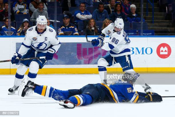 Colton Parayko of the St Louis Blues falls to the ice to black a shot against Steven Stamkos and Nikita Kucherov of the Tampa Bay Lightning at...