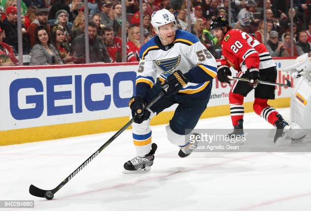 Colton Parayko of the St Louis Blues grabs the puck in the second period against the Chicago Blackhawks at the United Center on March 18 2018 in...