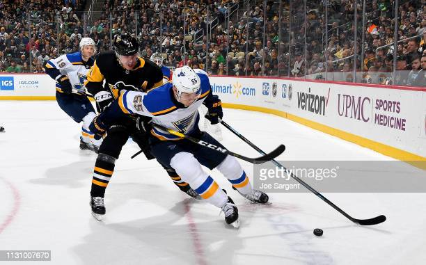 Colton Parayko of the St Louis Blues handles the puck against Evgeni Malkin of the Pittsburgh Penguins at PPG Paints Arena on March 16 2019 in...
