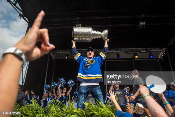 Colton Parayko of the St Louis Blues hoists the Stanley Cup during the St Louis Blues Victory Parade and Rally after winning the 2019 Stanley Cup...