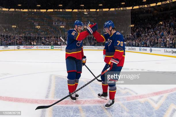 Colton Parayko of the St Louis Blues is congratulated by Oskar Sundqvist of the St Louis Blues after his game winning goal in overtime against the...