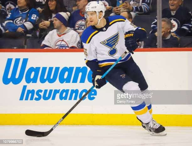 Colton Parayko of the St Louis Blues keeps an eye on the play during first period action against the Winnipeg Jets at the Bell MTS Place on December...