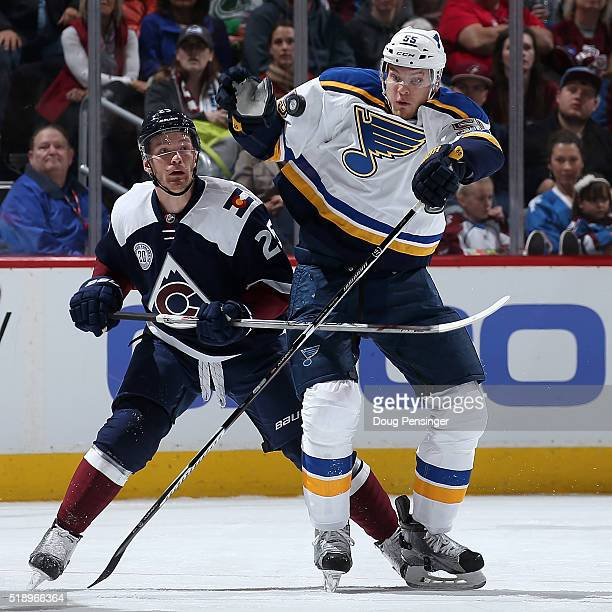 Colton Parayko of the St Louis Blues knocks the puck down with his glove against Mikhail Grigorenko of the Colorado Avalanche at Pepsi Center on...