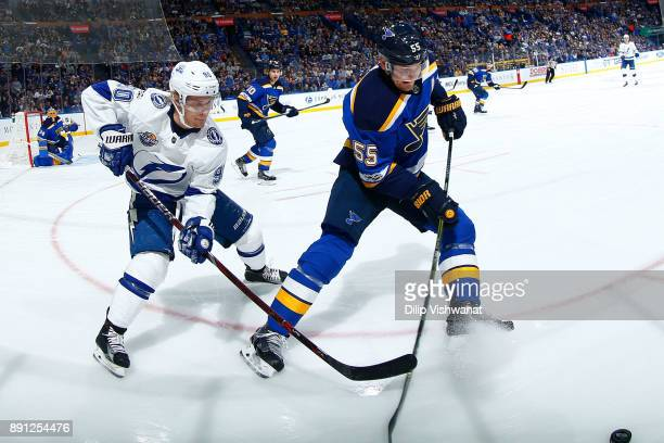 Colton Parayko of the St Louis Blues looks to beat Vladislav Namestnikov of the Tampa Bay Lightning to the puck at Scottrade Center on December 12...