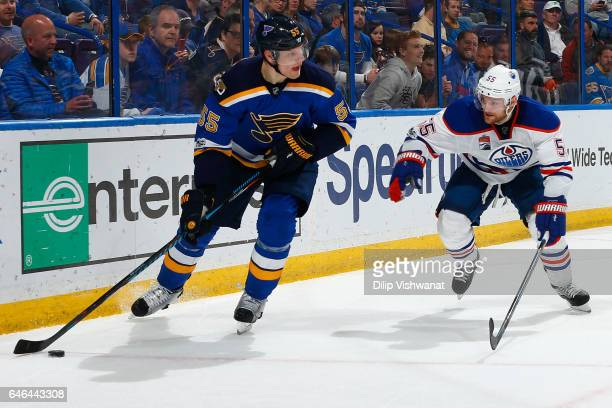 Colton Parayko of the St Louis Blues looks to pass the puck against Mark Letestu of the Edmonton Oilers at the Scottrade Center on February 28 2017...