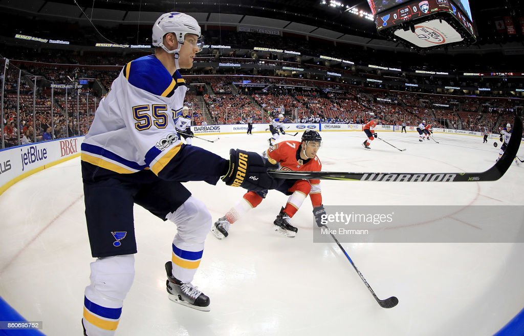 Colton Parayko #55 of the St. Louis Blues passes around Colton Sceviour #7 of the Florida Panthers during a game at BB&T Center on October 12, 2017 in Sunrise, Florida.