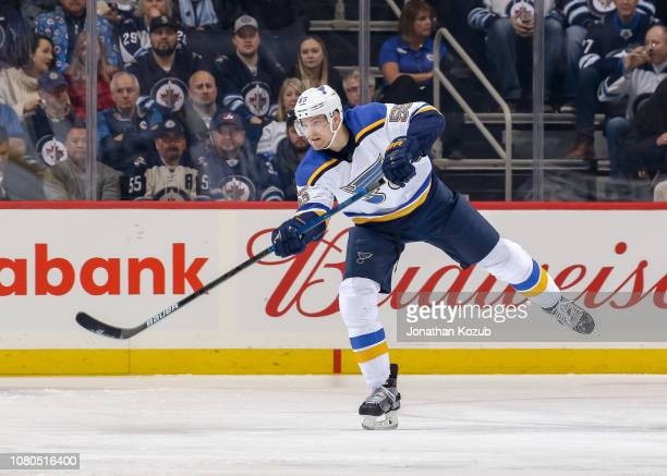 Colton Parayko of the St Louis Blues passes the puck down the ice during first period action against the Winnipeg Jets at the Bell MTS Place on...