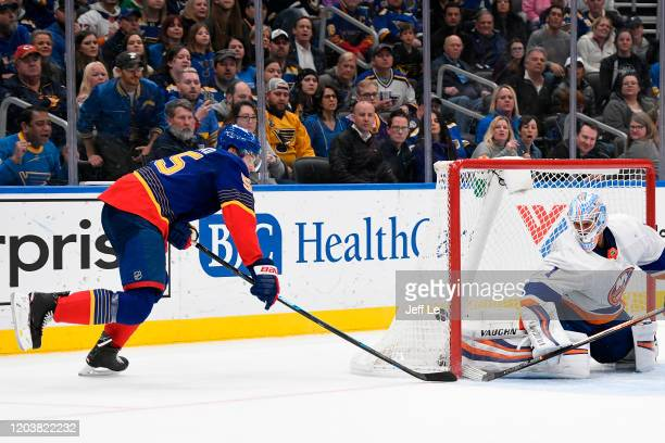 Colton Parayko of the St Louis Blues scores the game winning goal during overtime against Thomas Greiss of the New York Islanders at Enterprise...
